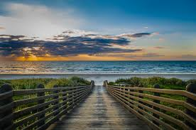 a boardwalk at sunset